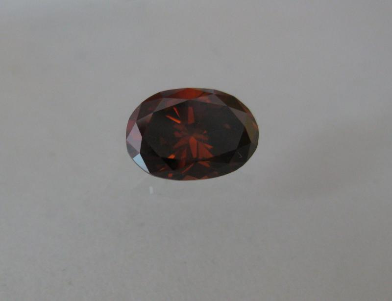 1.09carat fancy deep orance brown diamond