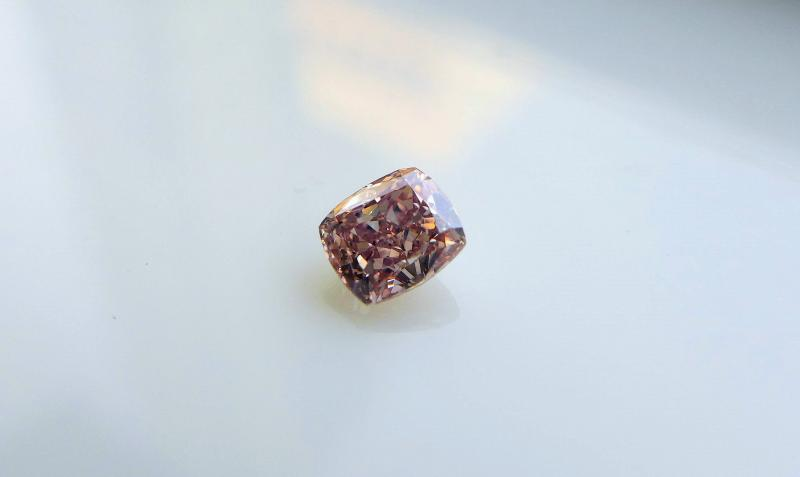 0.50 Fancy Orangey Pink Diamond